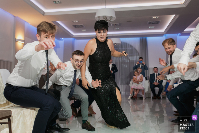 Wedding photography from Malopolskie showing Funny play during reception