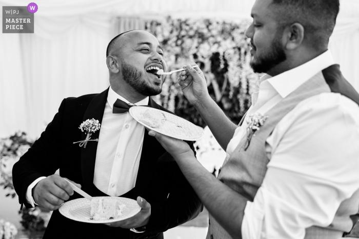 Wedding photograph from Birmingham, UK of some sweet cake sharing