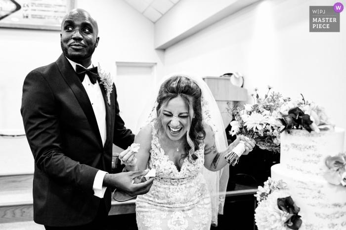 Croydon, UK Wedding photo of a very happy bride sharing the cake