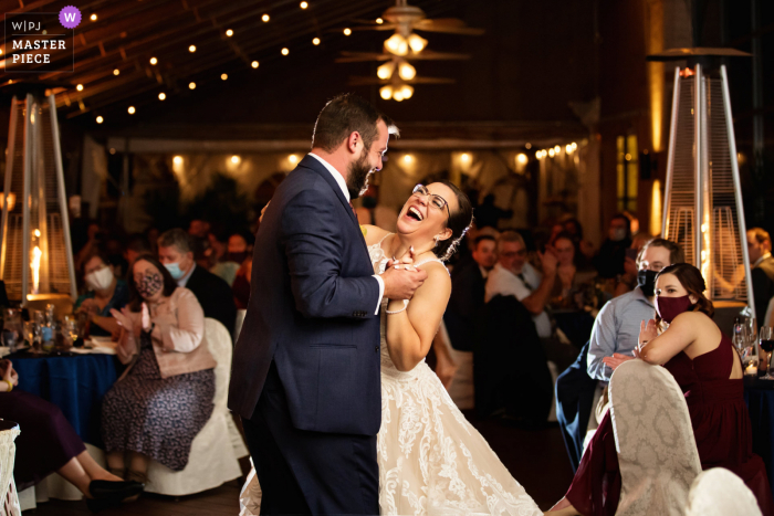 Wedding photo from Desmond Hotel Malvern, PA of the bride laughing during the first dance at wedding