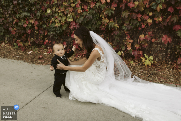 Wedding photograph from Sanctuary Events Center, Fargo, ND - the bride sees her baby boy for the first time on her wedding day.