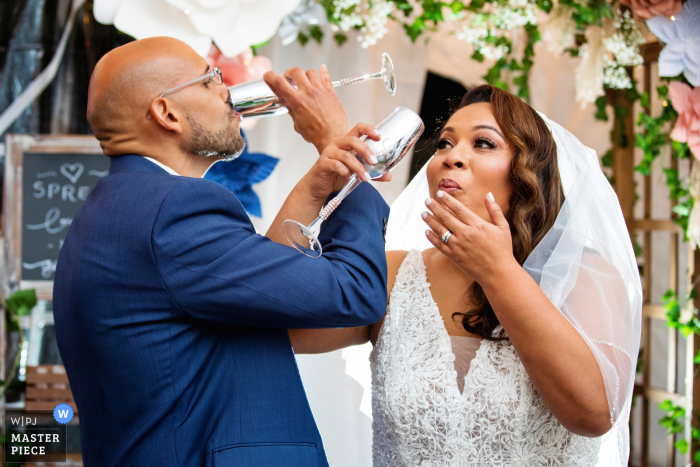 Wedding photography from Bergenfield, New Jersey of the bride and groom toast during NJ backyard wedding