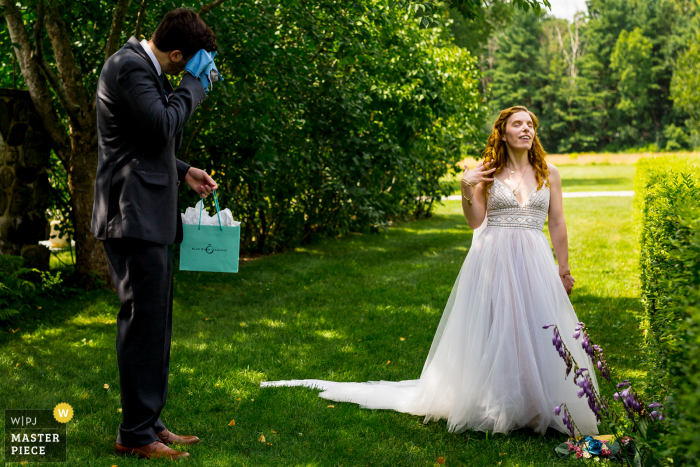 Wedding photograph from Andover, Massachusetts - the bride jokingly fans herself to mock the sweating nervous groom