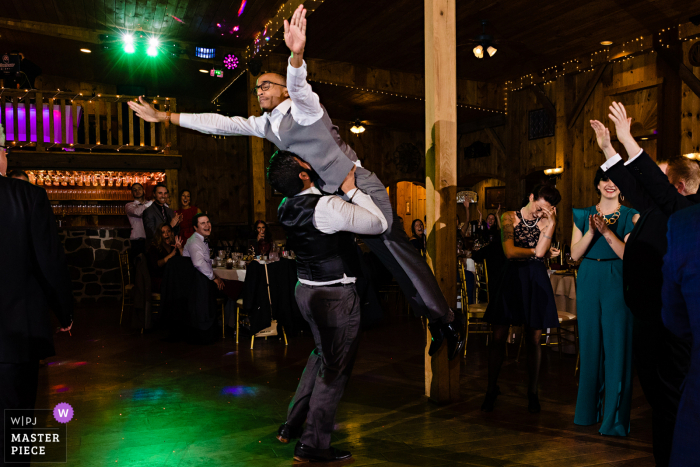 Wedding photograph from Philadelphia, Pennsylvania - Getting into the wedding reception with a classic Dirty Dancing lift