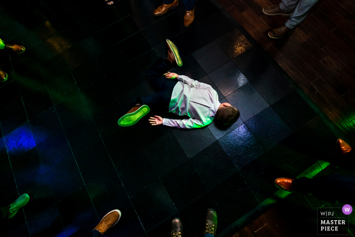 Pinery at the Hill, Colorado Springs, CO wedding photography of a kid break dancing during reception