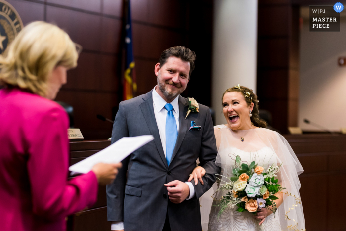 Fort Worth, TX wedding photography from the 2nd District Court of Appeals as A bride laughs during her civil ceremony