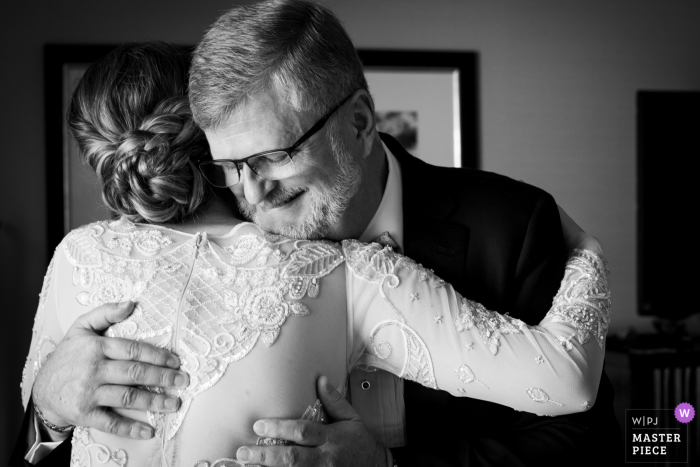 The Valentine, DTLA wedding photography of the bride hugging dad