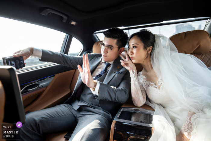 Bangkok wedding photo from the back of a car on the way to Holy Rosary Church