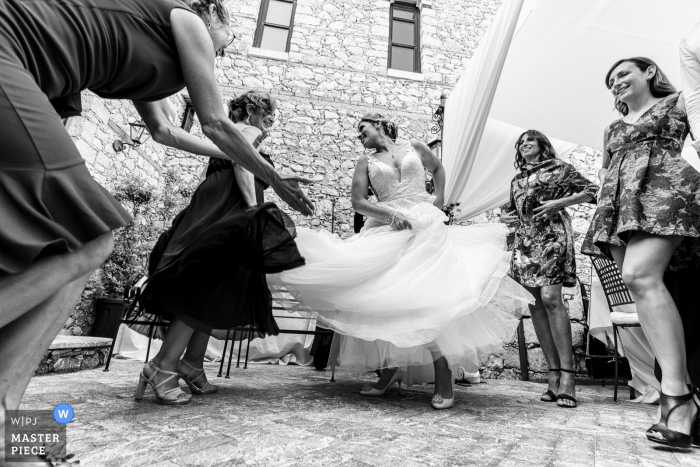 Villa Antonio, Taormina wedding photography showing The joy of this bride becomes contagious for the mother and the mother-in-law, also dragged into the dance