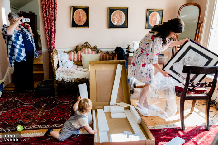 Ireland page boy helps bride open present from groom at the Gloster House