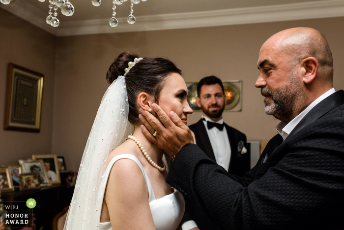 Istanbul wedding photography from Turkey showing the uncle of the bride is giving advices instead of her father because the father has recently passed away
