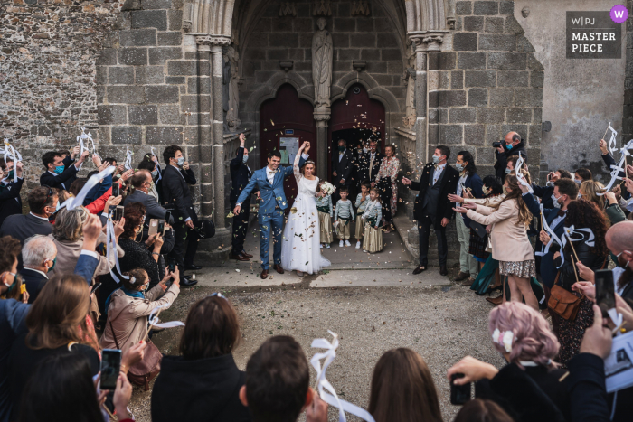 Saint-Suliac's church, France wedding photography from outside after the End of ceremony