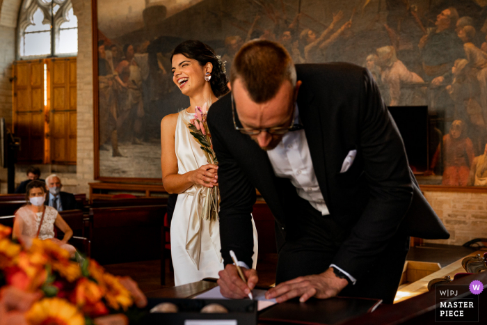 Town Hall Leuven wedding photography of the document signing and making it official