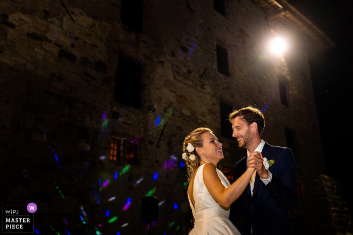 Castello di Strassoldo, Cervignano, Italy wedding photo of the First dance in a dark environment