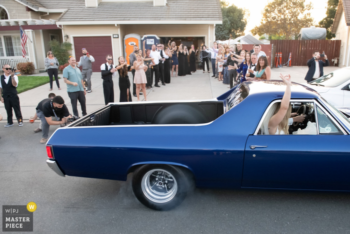 Brentwood, CA wedding photography of A classic car send-off with a burning tire burnout