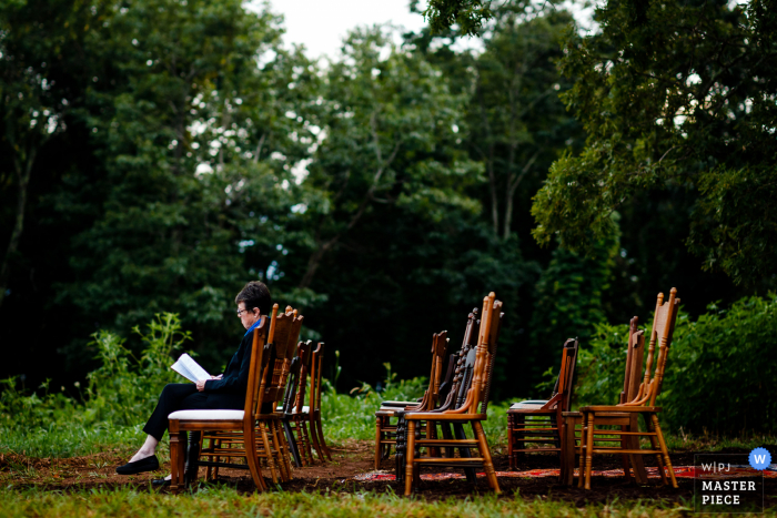NC wedding photo from Asheville of The officiant reading through her notes one last time before the ceremony