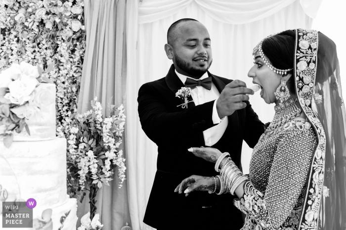 Birmingham, UK Cake sharing wedding reportage photo