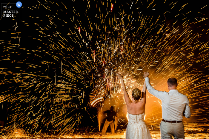 Best wedding photography from London showing a pic ofoutdoor reception fireworks under a slow camera shutter speed