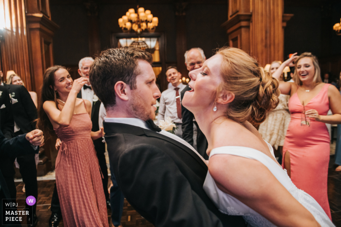Best wedding photography from Cleveland showing a pic ofthe bride and groom at the reception dance off