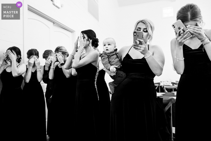 A top wedding photographer in Spring, Texas captured this picture at the Addison Woods Wedding and Event Venue of the brides first look with bridesmaids and ring bearer