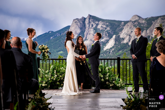 Black Canyon Inn best wedding photography from Estes Park, CO showing a pic ofa rustic mountain outdoor ceremony