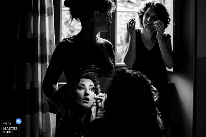 A top France wedding photographer in Ardeche captured this picture of the brides preparations in BW