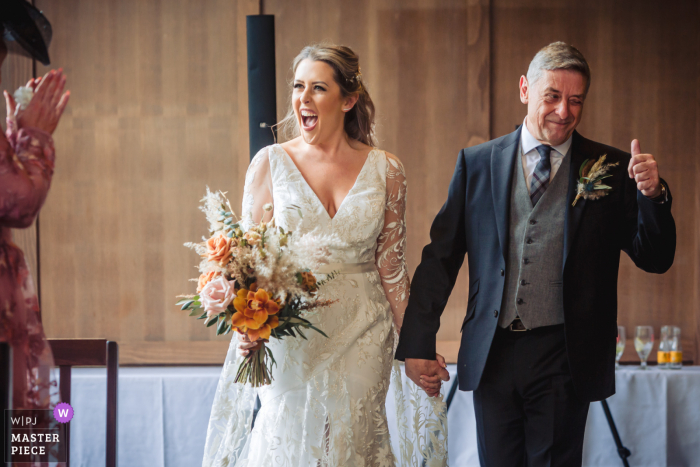 A wedding photographer in Scotland created this image ofthe Bride and her father entering the ceremony