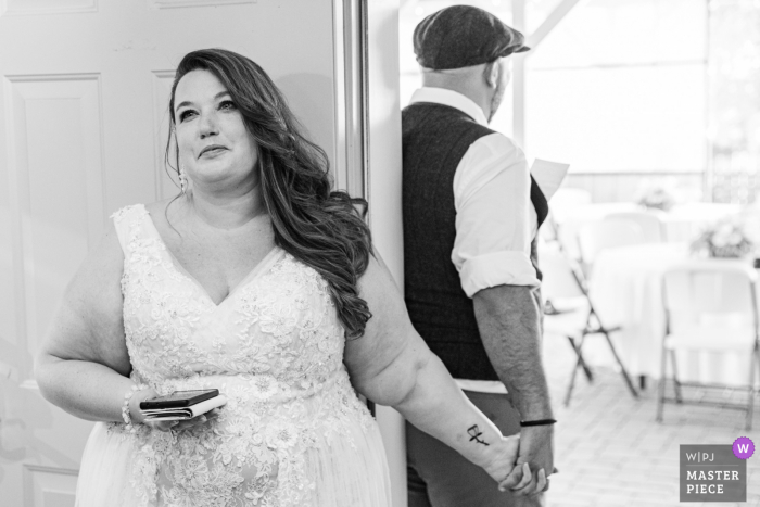 Best wedding photography from Lavender Ridge, Nevada showing a pic of a Beautiful moment during a first touch moment, Like a first look but did not see each other, they Just held hands and said special words