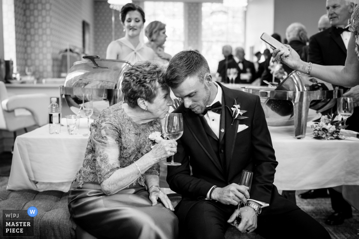 Best wedding photography from PA showing a pic taken Immediately after the ceremony concluded as brides grandma pulled the groom over to give him some marriage advice and tips