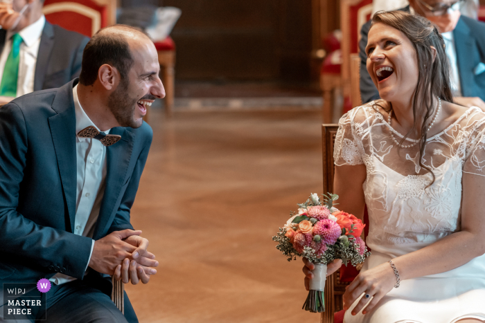 Best wedding photography from Mairie de Saint-Maur-des-Fosses showing a pic showing a moment of laughter during ceremony