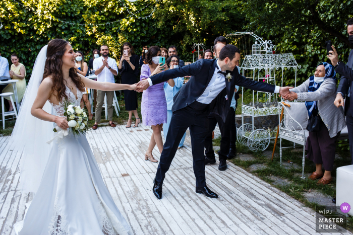 A Istanbul wedding photographer at Yanik Mektep in Kuzguncuk created this image showing The couple is on the aisle