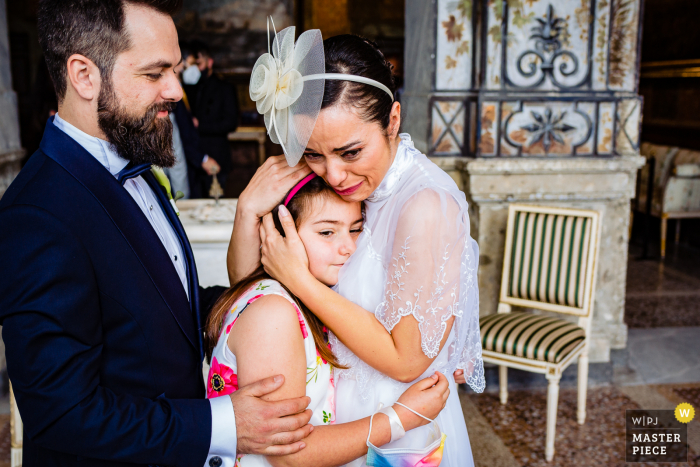 An Italian wedding photographer at Palazzo Chigi in Ariccia created this image showing The bride couldn't stop crying while hugging her cousin