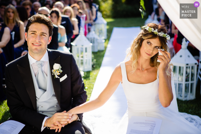 A top Rome wedding photographer at Villa Pocci captured this picture showing  The bride couldn't hold her tears during the ceremony when her sister had their speeches