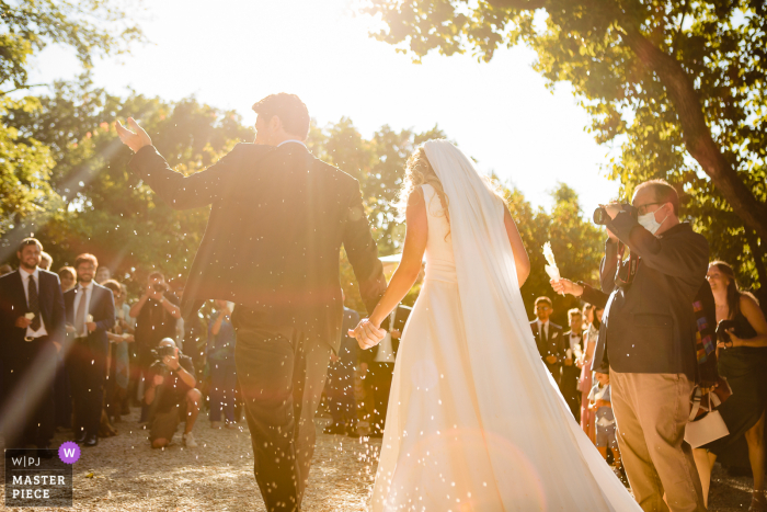 A Rome wedding photographer at Villa Pocci created this image ofThe moment of the rice with a crazy light