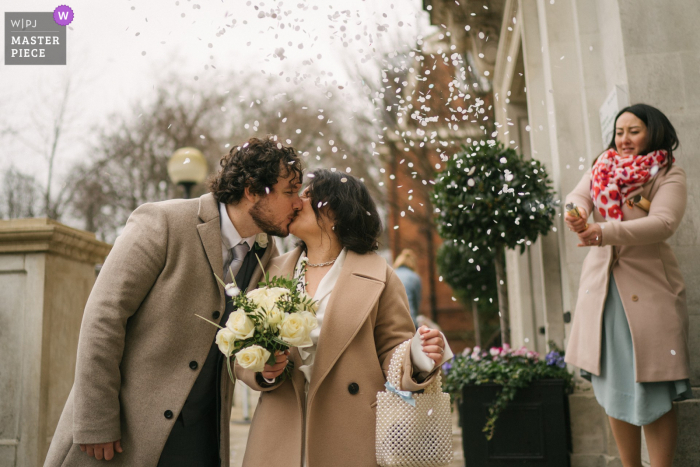 London best wedding photography from the Islington Town Hall showing a pic of a confetti moment outside town hall