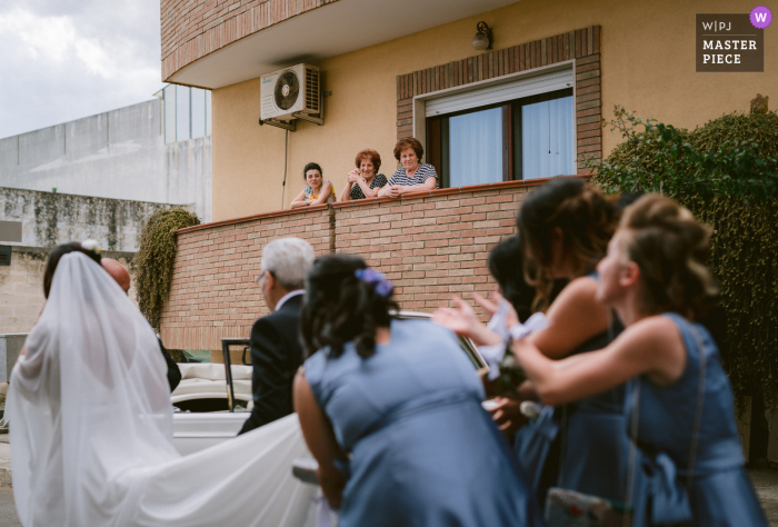 A wedding photographer in Apulia, Italy created this image showing the bride leaves the house