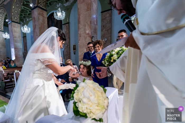 Best wedding photography from Santuario Madonna Santissima della Consolazione in Paterno showing a pic ofbride at outdoor event