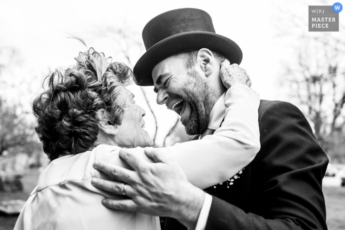 A Hertfordshire wedding photographer at Knebworth Church created this image of A mum and son embracing