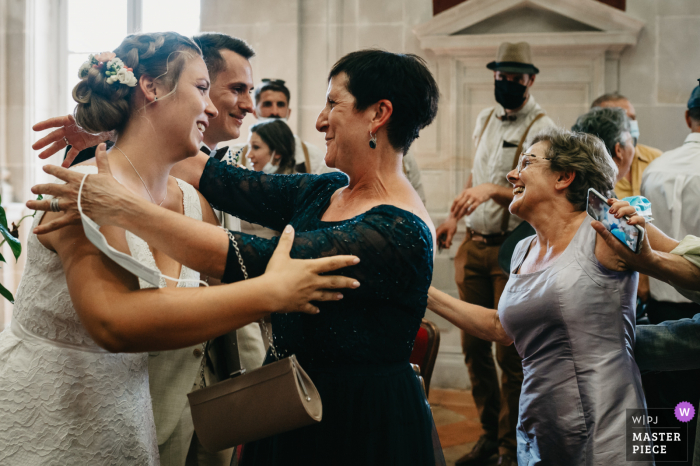 Best wedding photography from the Toulouse Town Hall showing a pic ofthe Mothers congratulating Bride and Groom