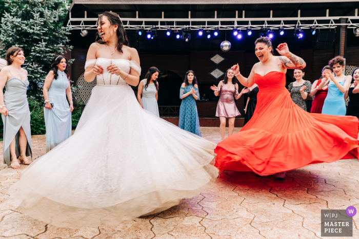 Best wedding photography from Korupark in Istanbul showing a pic ofthe bride dancing at the reception venue