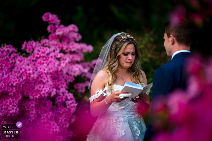 A wedding photographer at the National Arboretum in DC created this image showing The bride cries during her elopement ceremony