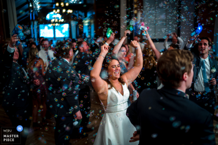 Best wedding photography from the Mt Ida Farm in Charlottesville showing Bubble guns create a sparkly festival of color on the dance floor