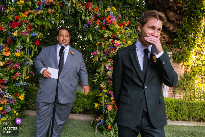Wedding photo from The Lombardi House, Los Angeles, California showing The groom gets emotional the moment he sees his bride coming down the stairs