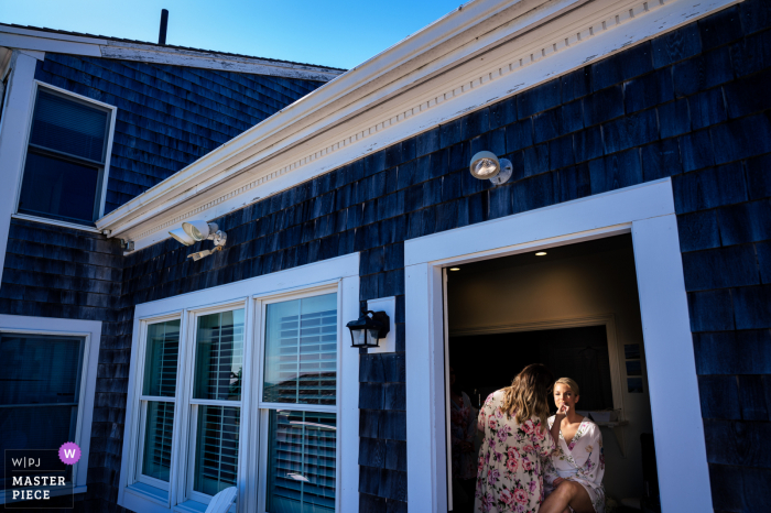 Wedding photography from Wychmere Beach Club, Harwich, MA showing The bride gets her makeup done before the ceremony