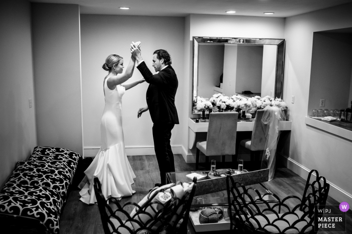 Wedding photography from Wychmere Beach Club, Harwich, MA showing The bride and groom practice their first dance before the reception