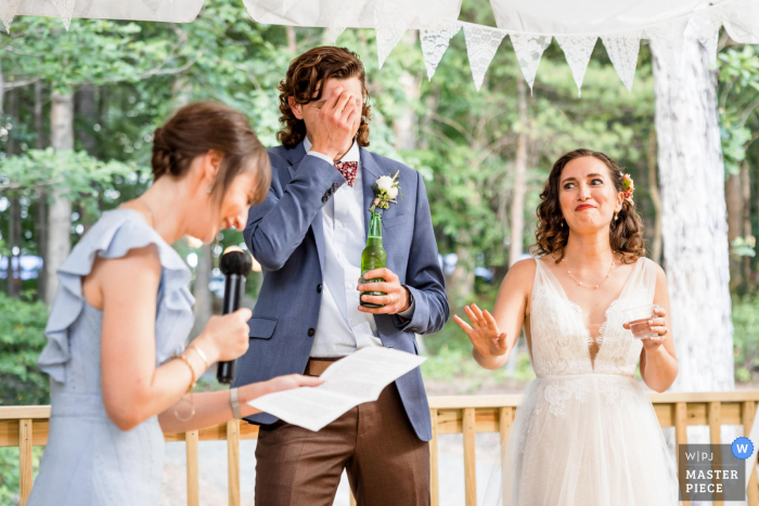 Virginia wedding image of Couples reaction during brides sisters toast
