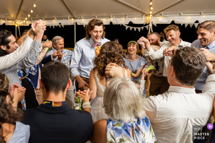 Virginia wedding photography of Couple and guests dancing to the Hora