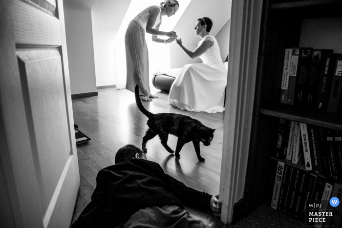 Brittany marriage preparation time award-winning picture capturing a child on the floor while the bride is getting ready. The world's best wedding image competitions are held by the WPJA