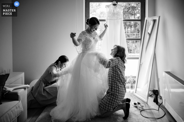 Cherry Orchard Residence, Sofia marriage preparation time award-winning picture capturing the Bride putting her dress on