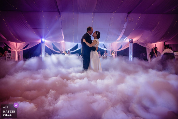 Cherry Orchard Residence, Sofia indoor wedding reception party award-winning picture showing First Dance in DJs clouds of fog